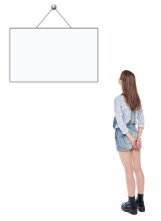 Young Teenage Girl Standing And Looking On Empty Picture Frame