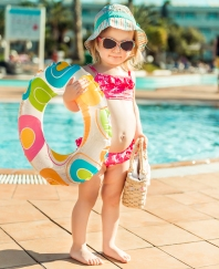 little cute girl near the pool with a circle for swimming